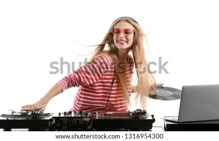 Female DJ playing music on white background Royalty-Free Stock Photo #1316954300
