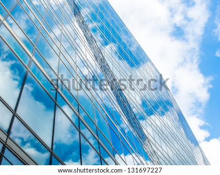 Bright sky reflects on a building. #131697227