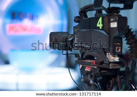 Video camera lens - recording show in TV studio - focus on camera aperture #131717114