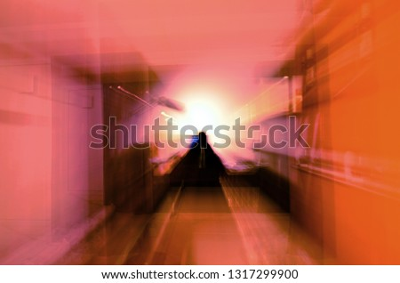Abstract shot of scary silhouette in room. Concept of spirits, ghosts and astral travel Royalty-Free Stock Photo #1317299900