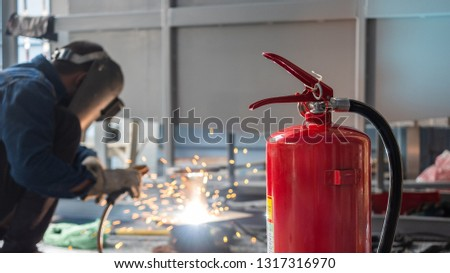 Fire extinguisher are used to prevent fire in welding steel work. #1317316970