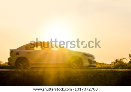 blurry image of car on the road travel holiday summer go relax  with sunset background. #1317372788