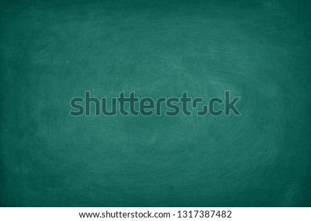 Green Chalkboard. Chalk texture school board display for background. chalk traces erased with copy space for add text or graphic design. Backdrop of Education concepts  #1317387482