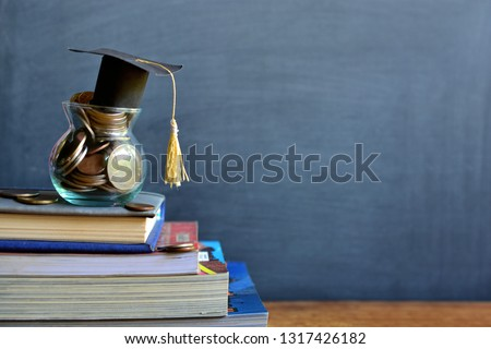 hat graduation model on money coins saving for concept investment education and scholarships #1317426182