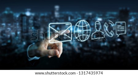 Businessman on blurred background using thin line contact icon