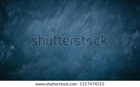 Abstract Grunge Decorative Blue Wall Background. Rough Dark Texture Web Banner With Copy Space For design. Wide Angle vintage background with vignette Royalty-Free Stock Photo #1317474515