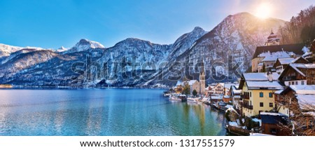 Beautiful winter landscape of Hallstatt mountain village with Hallstatter lake in Austrian Alps. Wide Panorama