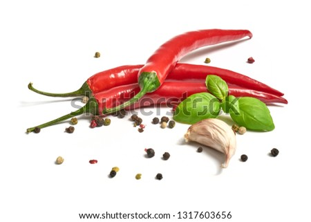 Hot pepper with garlic and pepper on a white background                               #1317603656