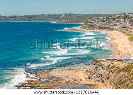 Aerial view of Bar Beach, Newcastle, NSW, Australia, showing the sandy beach, and surf. #1317816446