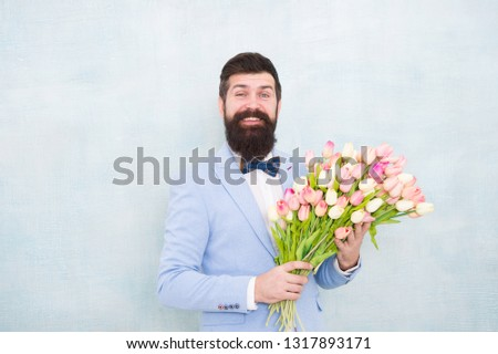 Tulips for sweetheart. Man well groomed wear tuxedo bow tie hold flowers bouquet. Invite her dating. Romantic man with flowers. Romantic gift. Macho getting ready romantic date. Waiting for darling. #1317893171