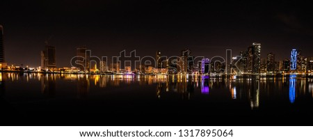Night view of Sharjah Skyscrapers at Sharjah Corniche #1317895064
