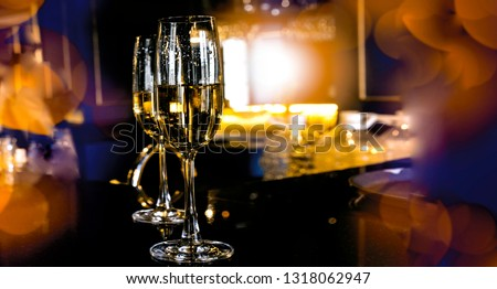 Food and drink, holidays party concept. Champagne sparkling in a glass on the bar . #1318062947