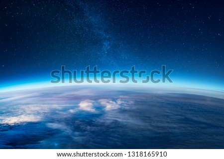 View of stars and milkyway above Earth from space #1318165910