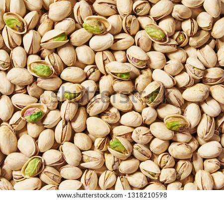 Pistachios texture and background . Tasty pistachios as background,as pistachios  texture. flat lay #1318210598