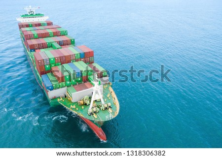 Aerial image of a container ship at sea, loaded with various container brands. #1318306382