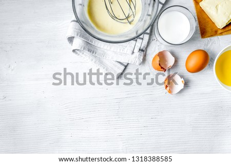 cooking pancake on white background top view ingredients for making #1318388585