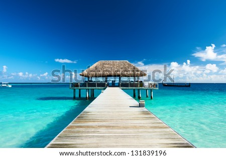 Beautiful beach with jetty at Maldives #131839196