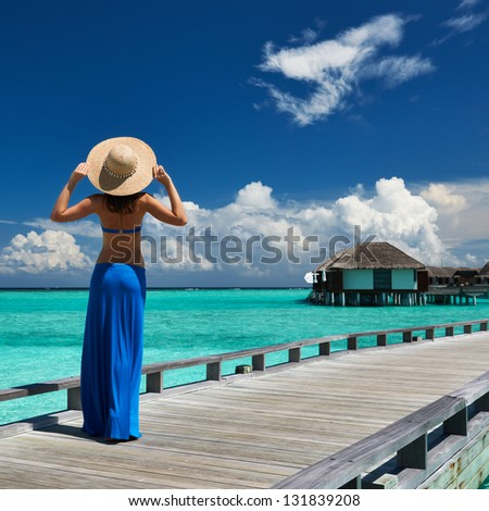 Woman on a tropical beach jetty at Maldives #131839208