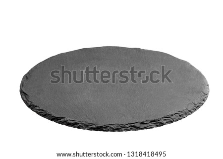 Slate plate on table. black slate stone isolated on white background. copy space. #1318418495