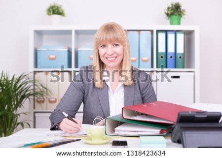 Businesswoman with happy emotions at work at the office. #1318423634