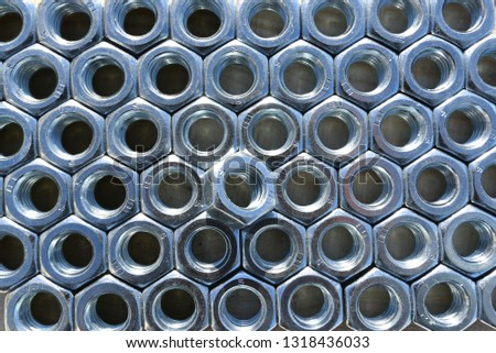 Many metal nuts. Abstract industry background. Natural photo. #1318436033