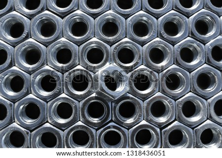Many metal nuts on black background. Abstract industry background. Natural photo. #1318436051