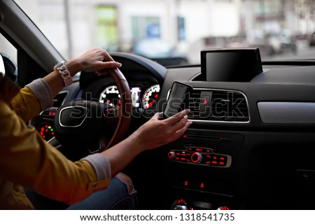 Template for Mobile phone magnet car mount phone holder, for GPS. Lifestyles photo in car. Interior, front view. With woman hand holding phone. Different angels. #1318541735