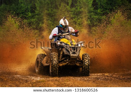 ATV in action. Extreme ride on dirt track. Baja #1318600526