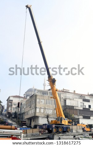 Turkey, istanbul, February 20, 2019: Mobile crane with its boom risen outdoors #1318617275