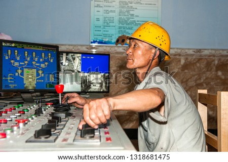 Luannan County - June 14, 2014: Workers in the control room of the steelmaking workshop are working. Luannan County, Tangshan City, Hebei Province, China.  #1318681475