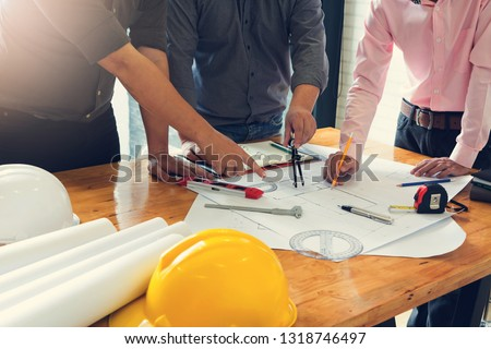 Engineer and Architect concept, Engineer Architects office team working with blueprints #1318746497