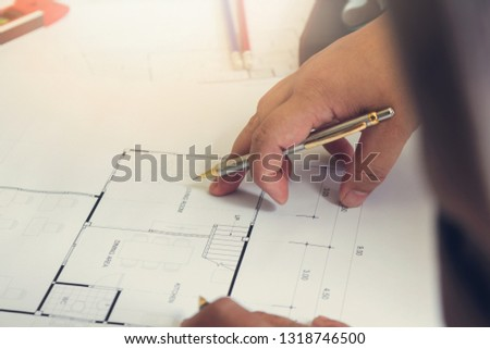 Engineer and Architect concept, Engineer Architects office team working with blueprints #1318746500