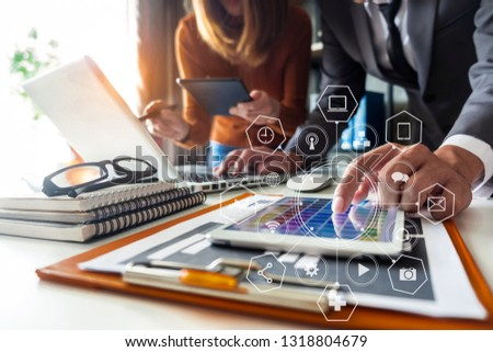 Business team present. professional investor working new start up project. Finance managers meeting.using smart phone and laptop and digital tablet computer in modern office.   #1318804679