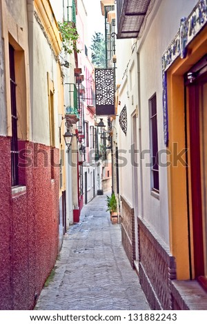 Passageway in center of Seville, Andalusia, Spain. #131882243