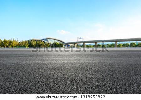 Empty asphalt road and railway station buildings in Shanghai #1318955822