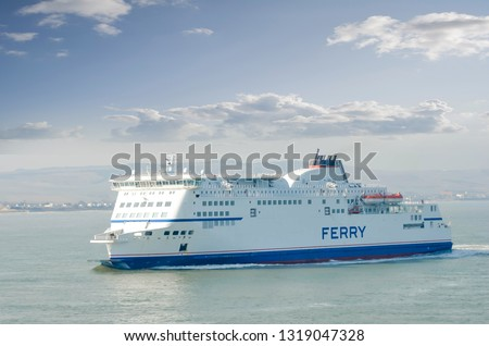 Ferry sailing between Calais and Dover Royalty-Free Stock Photo #1319047328