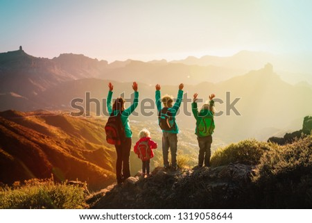 happy family travel in mountains at sunset, mother and kids enjoy hiking #1319058644