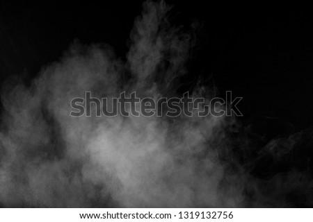 Bizarre forms of white powder explosion cloud against black background.White dust particles splash. #1319132756