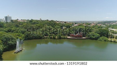 Drone image of the Portugal Park of Campinas SP Brazil, Sailboat and fountain on the lake #1319191802