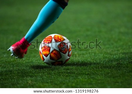 Thessaloniki, Greece - February 19, 2019: Footballer's feet with ball in the field UEFA Youth League for second round between  Paok - Tottenham at Toumba stadium #1319198276
