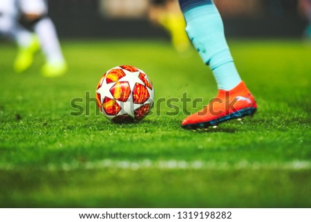 Thessaloniki, Greece - February 19, 2019: Footballer's feet with ball in the field UEFA Youth League for second round between  Paok - Tottenham at Toumba stadium #1319198282