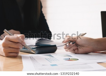 Business People Analyzing Statistics Business Documents, Financial Concept #1319232140