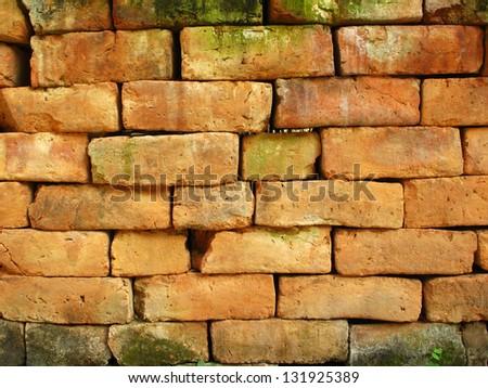 Texture of orange brick stone background #131925389