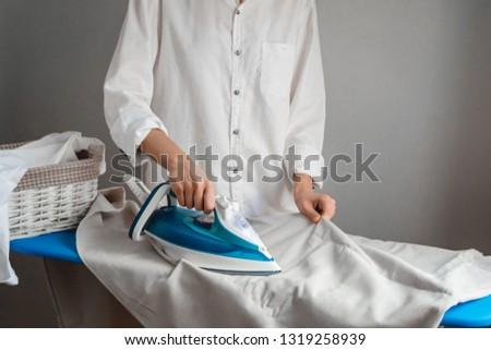 Girl ironing laundry, white shirts, cleaning service, maid #1319258939