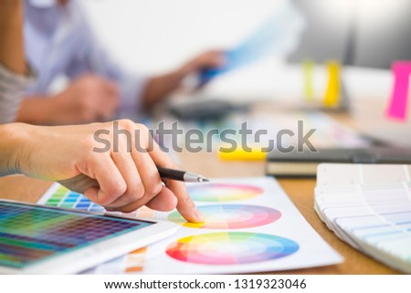 designer graphic creative creativity working together coloring using graphics tablet and a stylus at desk with colleague  #1319323046