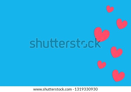Many scattered red paper hearts on blue table. Top view. Valentines Day concept. Copy space for your text #1319330930