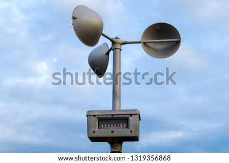 anemometer used for measuring the speed of wind and weather station instrument #1319356868