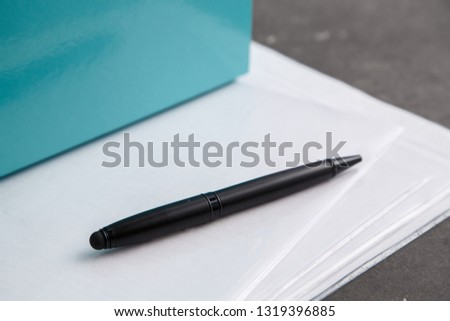 black pen on documents on grey marble background #1319396885
