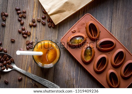 coffee with ice in glass on wooden background top view #1319409236