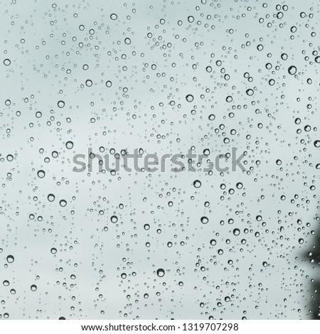 water rain drop on glass window #1319707298